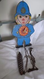 Fun for children / kids: 'London Bobby' / policeman pendulum clock with animated 'rolling eyes'