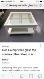 Liatorp white glass top table.