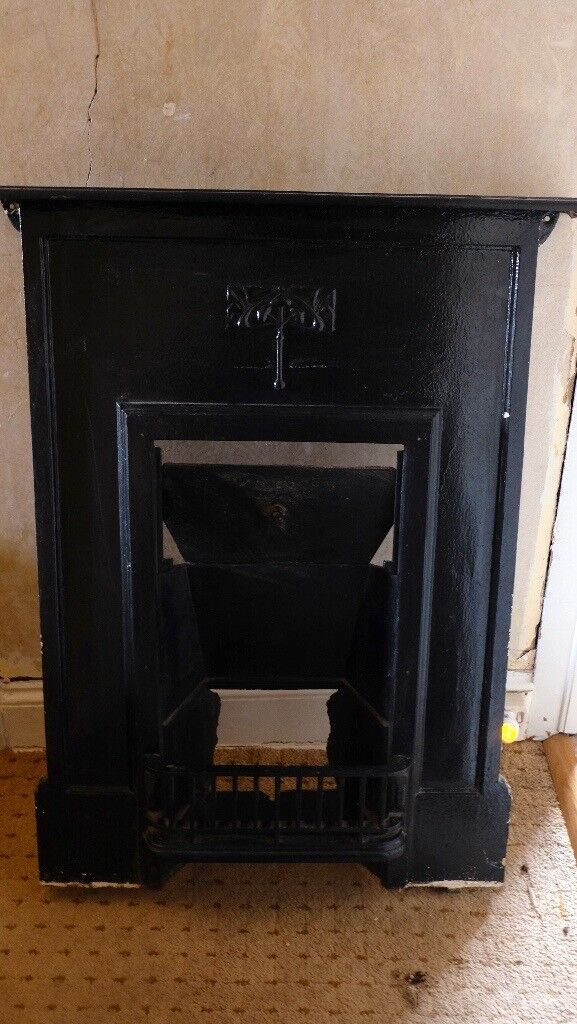 Antique art nouveau cast iron fireplace