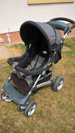 Britax Voyaga Ultra Travel System with car seat, soft carry cot and accessories