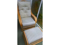 Set of wicker chair with upholstery, stool and table ideal for conservatory