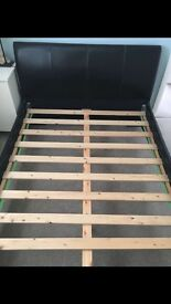 Brown leather double bed frame in excellent condition- barely used