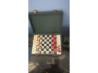 Small travel Chess board, all pieces & spares. Green shagreen case with clasp to fasten.