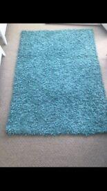 Next teal rug