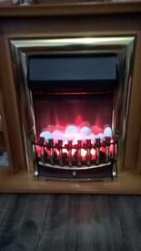 Electric Fire/Surround 2 heat settings or light on itself.