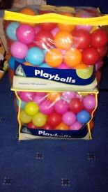 Two Bags plastic playballs, approximately 100 in each bag.
