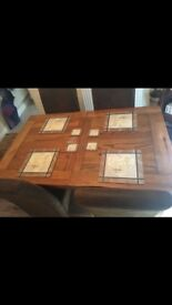 Solid oak extendable table and four high back suede chairs for sale