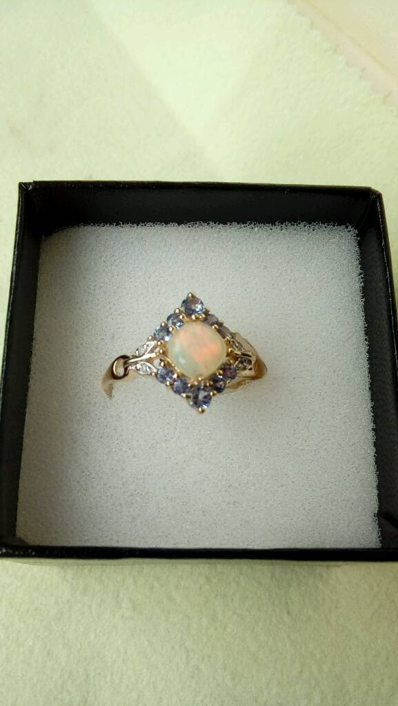 Diamond Ring 10ct Goldin Glenfield, LeicestershireGumtree - Beautiful ring with 4 diamonds 1 x Opal and 10 x Tanzanite in 10ct yellow gold. Size O. Brand new with tag. Please message me for more information