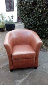 Tub armchair in tan leather