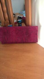 Fuscia Pink snake skin effect clutch bag