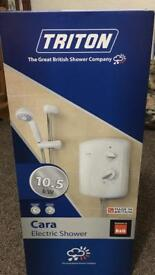 Triton shower 10.5 kw new in the box cost well over £100