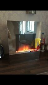 Mirrored electric fire - fully working! Great condition! Currently retails at a much higher price.
