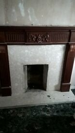 Marble fire surround with wooden frame