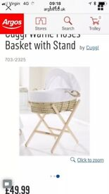 Moses basket and a stand