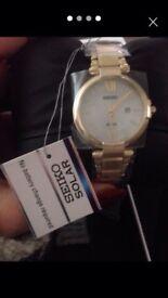 Seiko gold solar watch