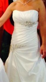 Beautiful used wedding dress for sale.