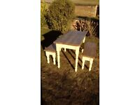Rustic table and two benches.