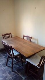 Solid oak farmhouse table and 4 chairs
