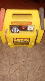 Jump starter with air compressor and torch