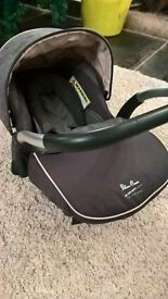 Silver cross baby carrier..