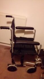 manual wheelchair with brakes, foot plates etc.