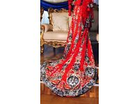 Stunning Bridal Lengha In Red And Royal Blue