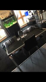 Silver and black table and chairs