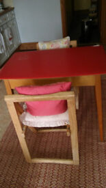 Red Formica-style table and two chairs