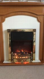Electric fire with solid oak surround