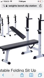 Weight bench with barbell and 74kg metal plates