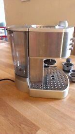 De'Longhi EC330S Machine and four espresso cups and saucers