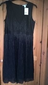 Pregnancy dress size S from H&M. Never worn. Black with silver touches.