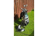 golf clubs trolley and shoes