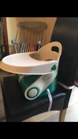 Portable booster seat with table
