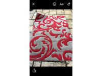 Red and grey swirl rug