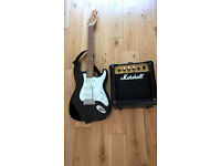 ENCORE STRAT STYLE BLACK GUITAR AND MARSHAL G 10 M II