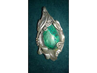 Silver pendant with green gemstone