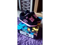 Pink 2 wheeled Heelys size 11 worn a couple of times. Still in box