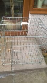 Metal dog cage with 2 doors and removable metal floor.