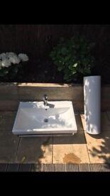 Bathroom sink, tap, towel rail and pedestal