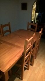 solid pine dining table and 6 chairs.