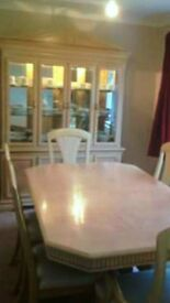 beautiful dusplay unit and extending table and chairs