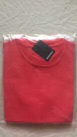 2 male medium t-shirts , white and coral.