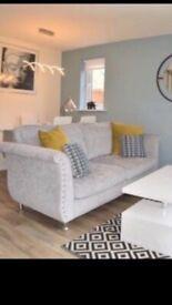 Grey sofa and matching footstool