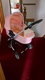 pink and white babiie pram with carry cot