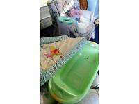 Baby bath and accessories. Changing mat, 2 potties, 2 training seats and a step.