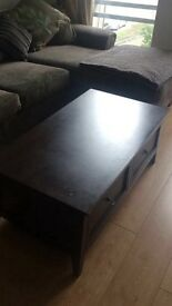 Dark brown coffee table with storage drawers