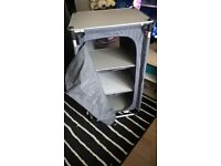 camping unit with 4 shelves