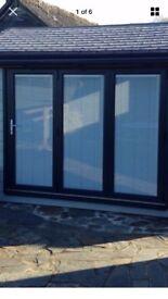 Aluminium bifolding doors anthracite grey not patio or french doors