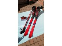Retro skis, boots, poles and goggles